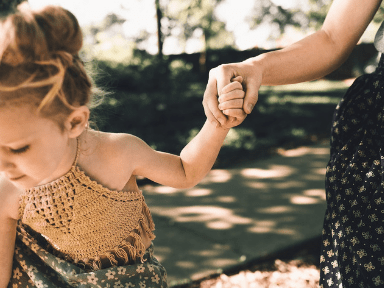 Mom holding child's hand