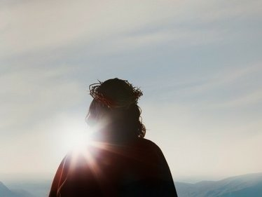 Photo of risen Christ facing the light of day after emerging from the tomb.