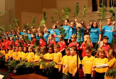 Children's Choirs waving palm branches on Palm Sunday