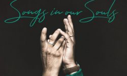 Visual of hands lifted in worship along with the words, Songs in Our Souls.