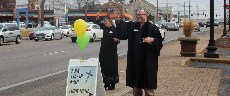 Pastors Jim Peich and Winter Hamilton offer ashes to drives on Ash Wednesday.