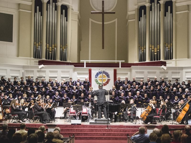 Choir singing with orchestra.