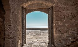 Photo of an open door to illustrate how God invites us to follow Jesus.