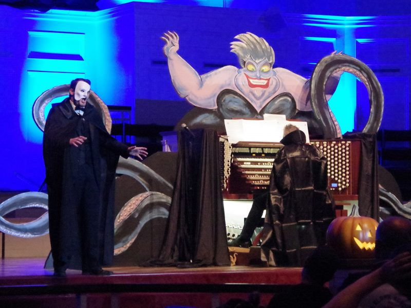 Photo of PipeScreams performance with organist and the Phamtom of the Opera character singing.