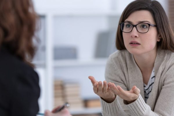 Photo of a divorce care session with counselor explaining the recovery process.