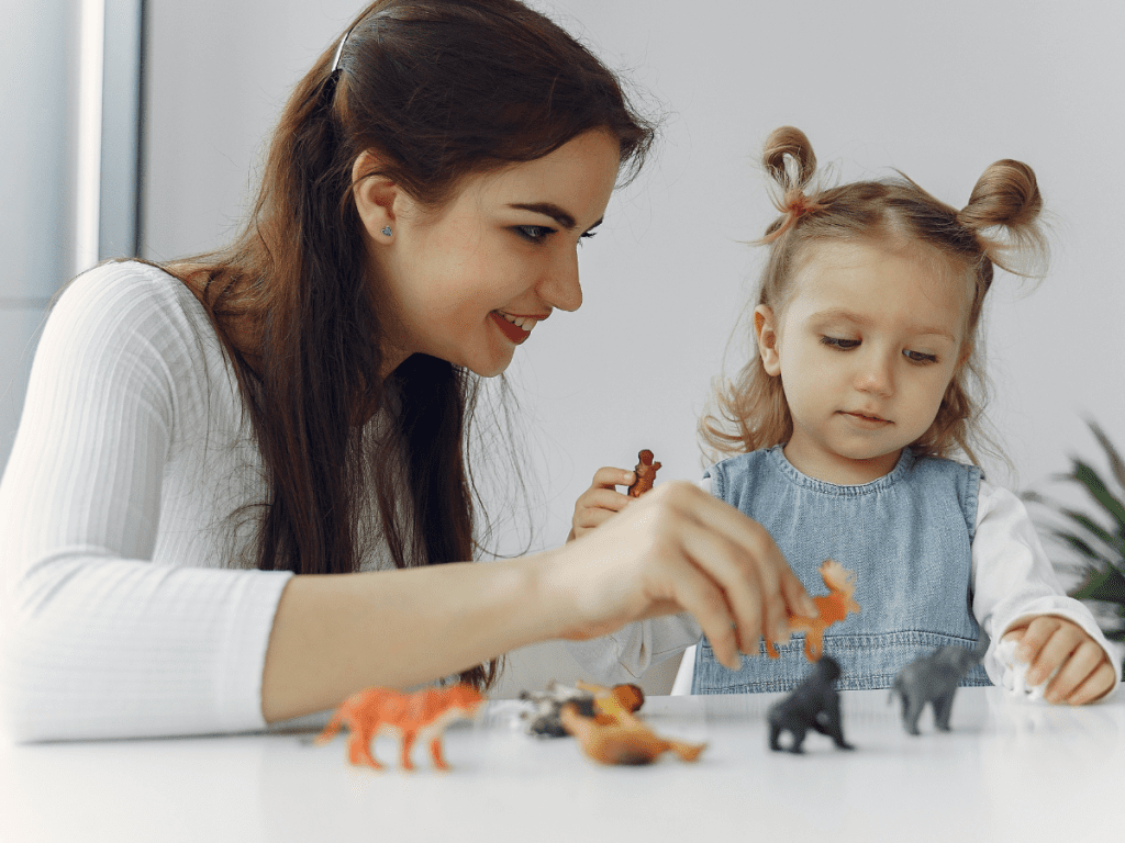 Teacher and child with toys 43