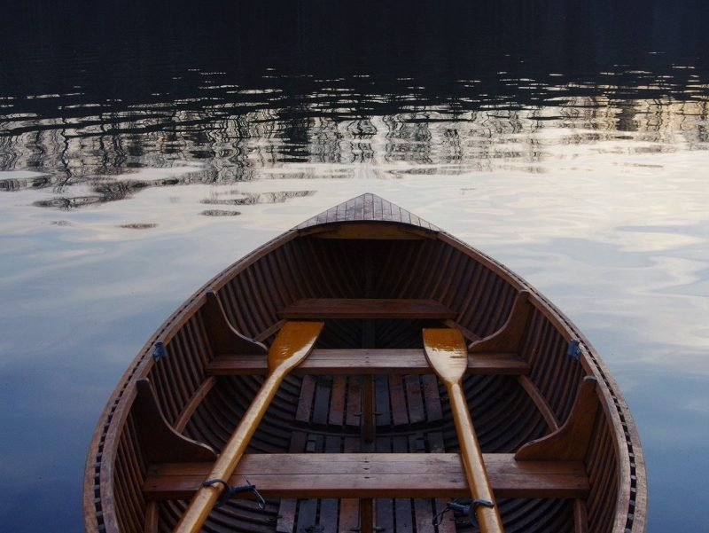 Row boat on a beautiful lake as the sun is going down.