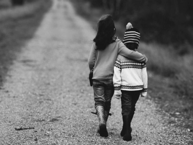 Children walking down a road.