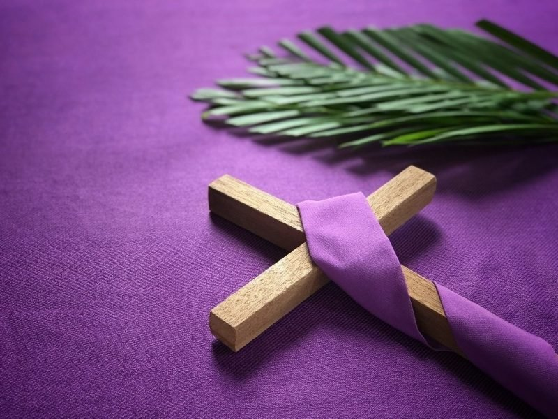 Photo of wooden cross wrapped in purple.